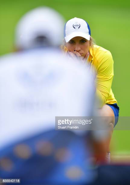 Mel Reid of Team Europe rlines up a putt during the second day morning foursomes matches of The Solheim Cup at Des Moines Golf and Country Club on...