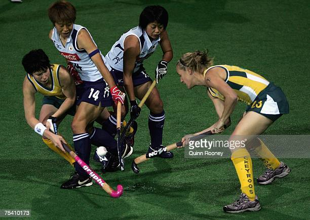 Mel Twitt and Renee Trost of Australia contest for a loose ball with Akemi Kato of Japan during the second test match of the six test series between...