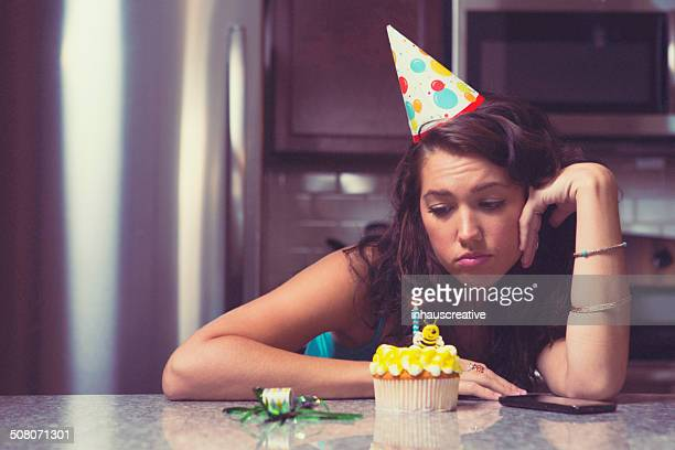 Melancholy woman at home celebrating her birthday all alone