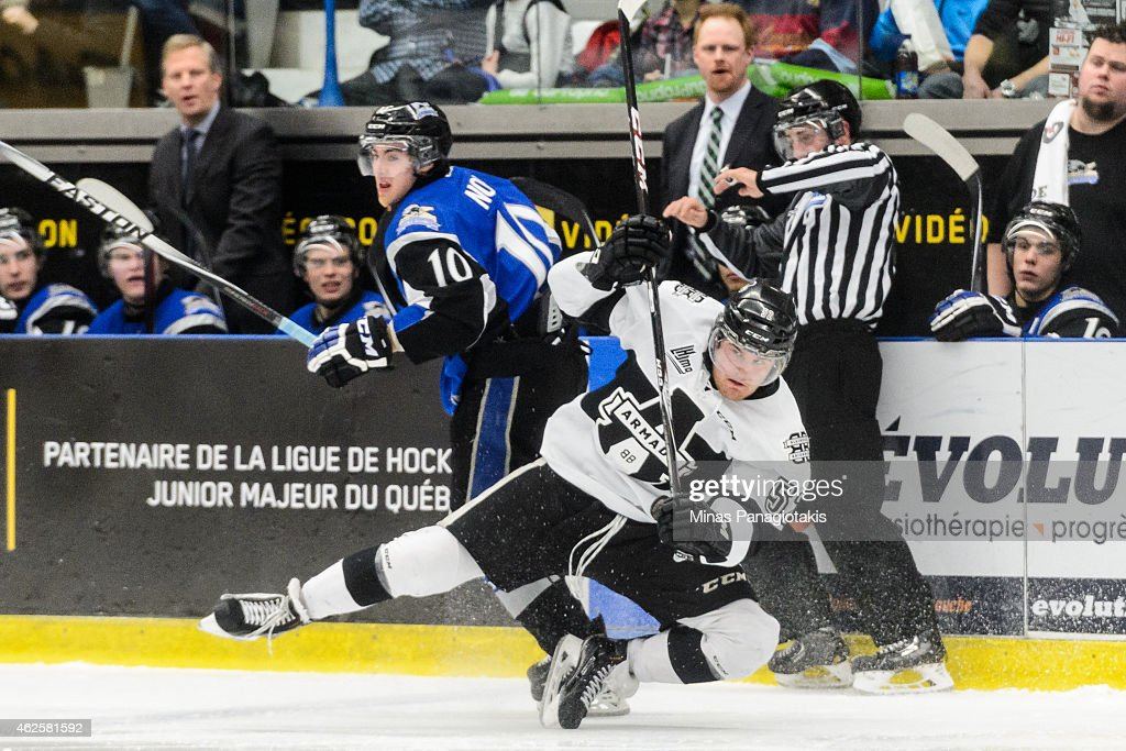 TJ Melancon #52 of the Blainville-Boisbriand Armada falls trying to check Nathan Noel #10 of the Saint John Sea Dogs during the QMJHL game at the Centre Excellence Rousseau on January 31, 2015 in Blainville-Boisbriand, Quebec, Canada.