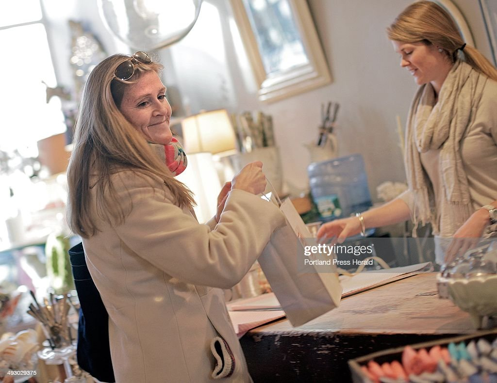 melanee paul of kennebunk picks up her purchases from s melanee paul of kennebunk picks up her purchases from s assistant louisa gemmer right