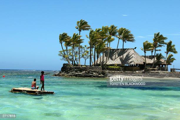 Melanesian children float on a bamboo pontoon by Wicked Walu Island on the resortstudded Coral Coast of Fiji 11 November 2003 Since the Bali bombings...