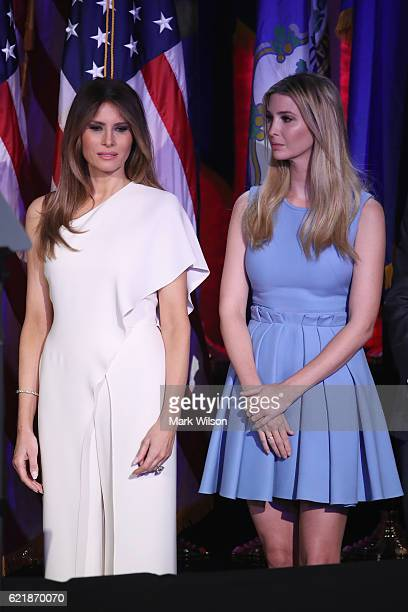 Melania Trump and Ivanka Trump stand on stage during Republican presidentelect Donald Trump's election night event at the New York Hilton Midtown in...