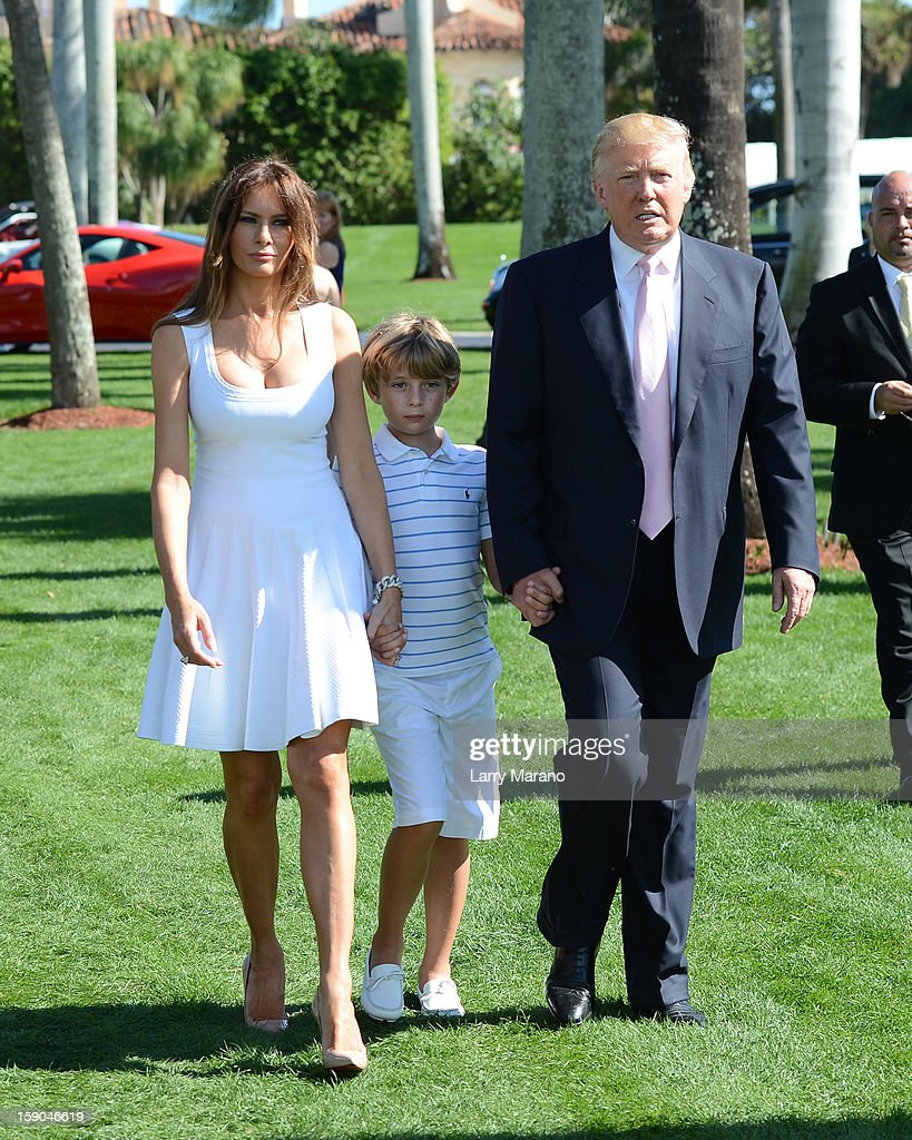 Melania Trump, Barron Trump and Donald Trump attend Trump Invitational Grand Prix at Mar-a-Lago on January 6, 2013 in Palm Beach, Florida.