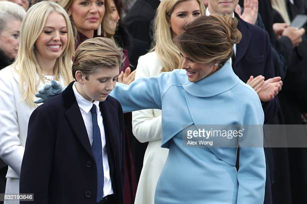 Melania Trump puts her arm around son Barron Trump on the West Front of the US Capitol on January 20 2017 in Washington DC In today's inauguration...