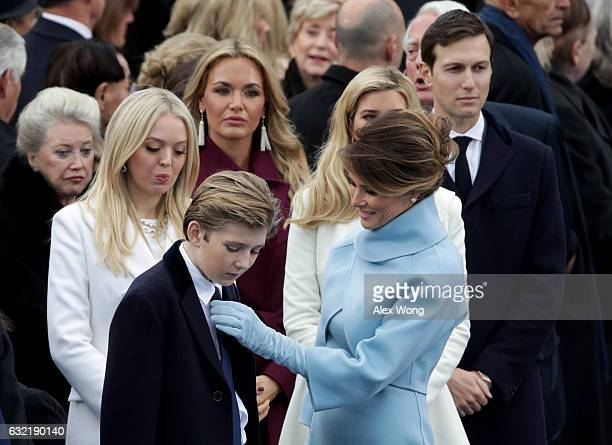 Melania Trump straightens son Barron Trump's tie on the West Front of the US Capitol on January 20 2017 in Washington DC In today's inauguration...