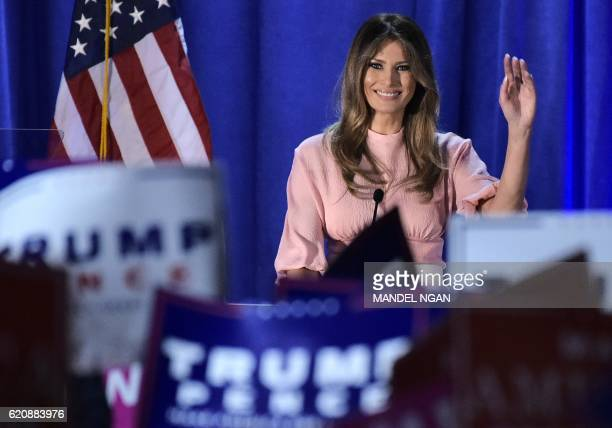 Melania Trump the wife of Republican presidential nominee Donald Trump waves as she makes her way off the stage after a rally for her husband on...