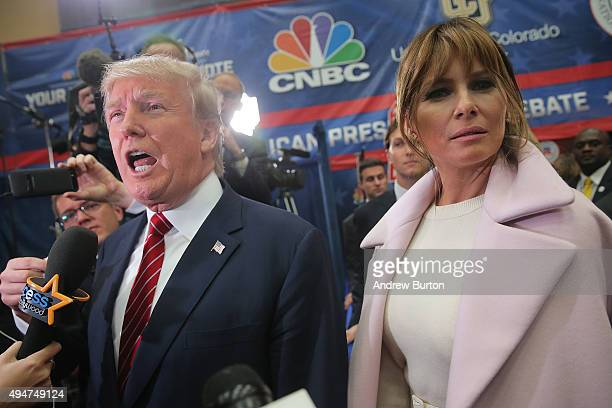 Melania Trump wife of presidential candidate Donald Trump listens to her husband speak to the media in the spin room after the CNBC Republican...