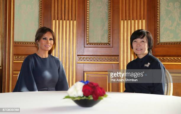 Melania Trump wife of US President Donald Trump and Akie Abe wife of Japanese Prime Minister Shinzo Abe pose for photographs prior to their luncheon...