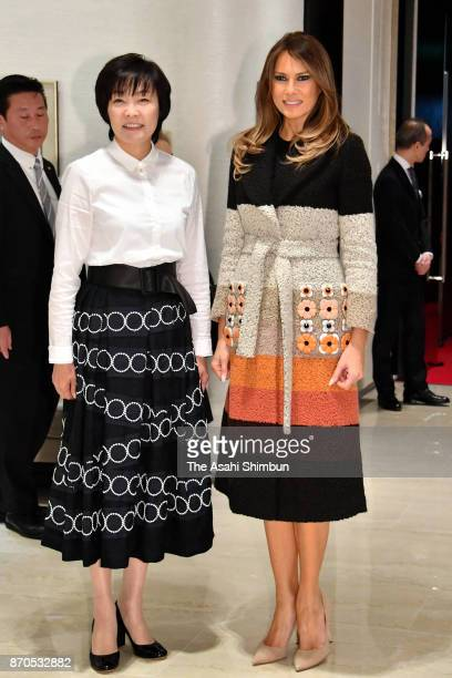 Melania Trump wife of US President Donald Trump is welcomed by Akie Abe wife of Japanese Prime Minister Shinzo Abe during their visit to Mikimoto...
