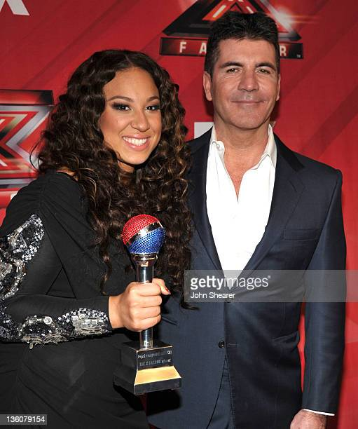 Melanie Amaro and Simon Cowell attend 'The X Factor' Season Finale at CBS Television City on December 22 2011 in Los Angeles California