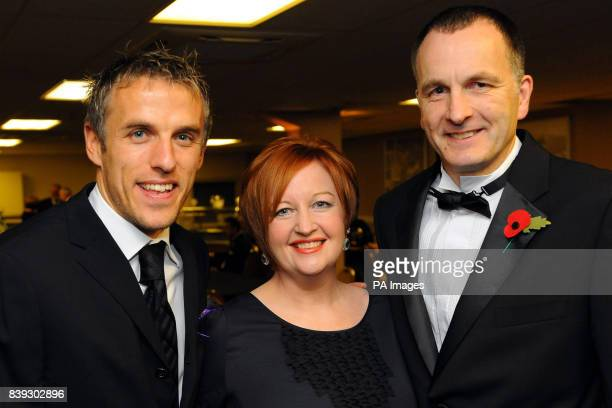 Melanie and Stephen Jones the parents of murdered schoolboy Rhys Jones with Everton footballer Phil Neville at the Liverpool Unites Charity Dinner at...