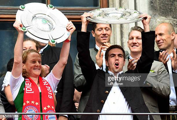 Melanie Behringer and Philipp Lahm celebrate winning the Bundesliga at Marienplatz on May 24 2015 in Munich Germany