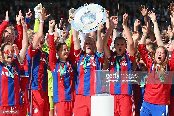 Melanie Behringer of FC Bayern Muenchen lifts up the Allianz FrauenBundesliga winners trophy after the Allianz FrauenBundesliga match between FC...