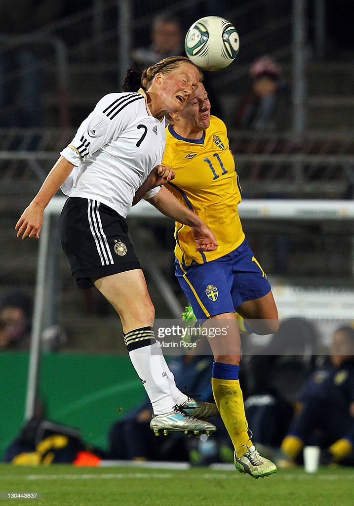 Melanie Behringer (L) of Germany and Antonia Goeransson (R) of Sweden head for the ball during the Women's International friendly match between Germany and Sweden on October 26, 2011 in Hamburg, Germany.