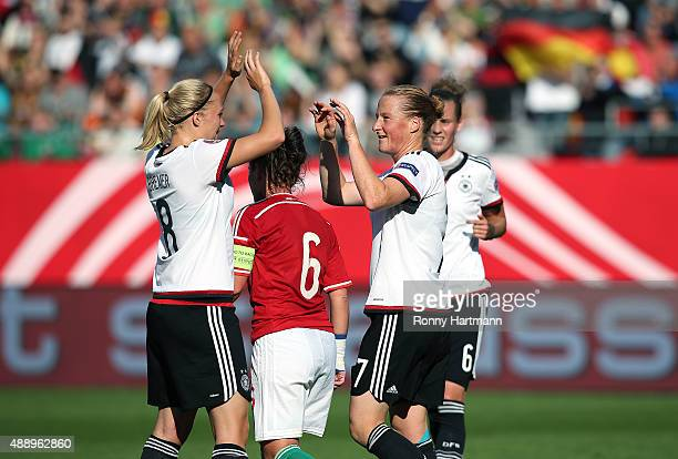Melanie Behringer of Germany celebrates after scoring her team's fourth goal with Pauline Bremer of Germany next to Angela HummelSmuczer of Hungary...