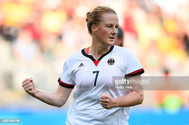 Melanie Behringer of Germany celebrates scoring a goal during the Women's Semi Final match between Germany and Canada on Day 11 of the Rio 2016...