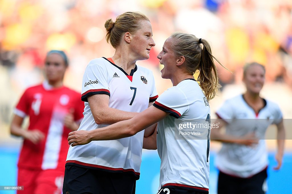 Melanie Behringer of Germany celebrates scoring a goal with Tabea Kemme of Germany during the Women's Semi Final match between Germany and Canada on...