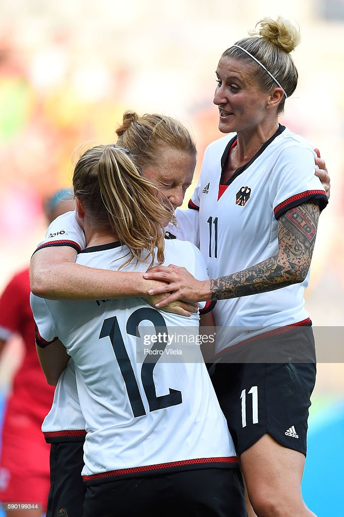Melanie Behringer of Germany celebrates scoring a goal with Tabea Kemme and Anja Mittag of Germany during the Women's Semi Final match between...