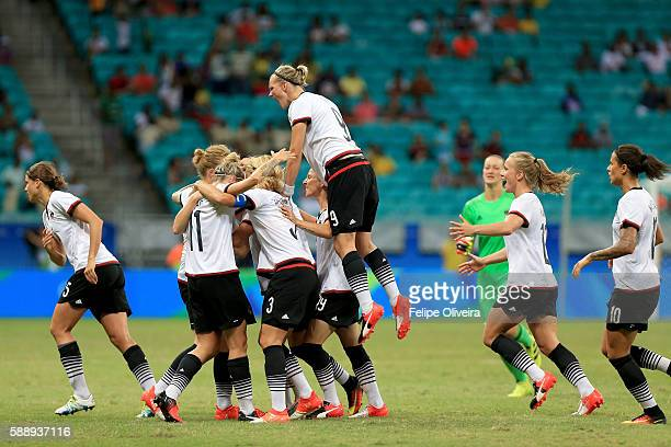 Melanie Behringer of Germany celebrates with team mates after scoring the opening goal during the Women's Football Quarterfinal match between China...