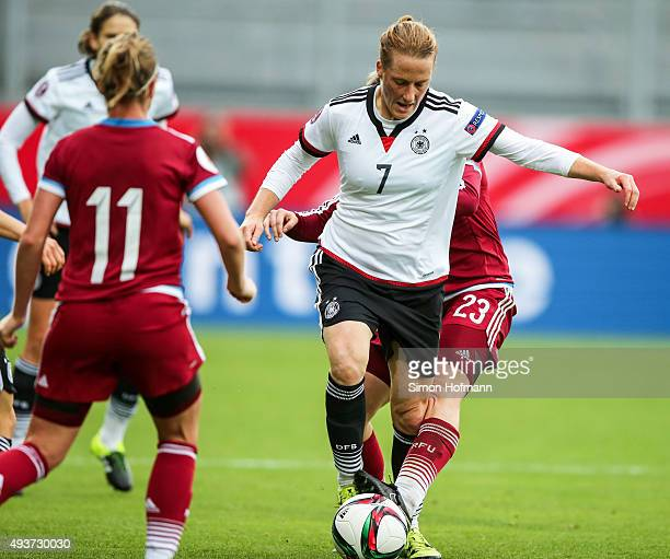 Melanie Behringer of Germany is challenged by Elena Danilova of Russia during the UEFA Women's Euro 2017 Qualifier match between Germany and Russia...