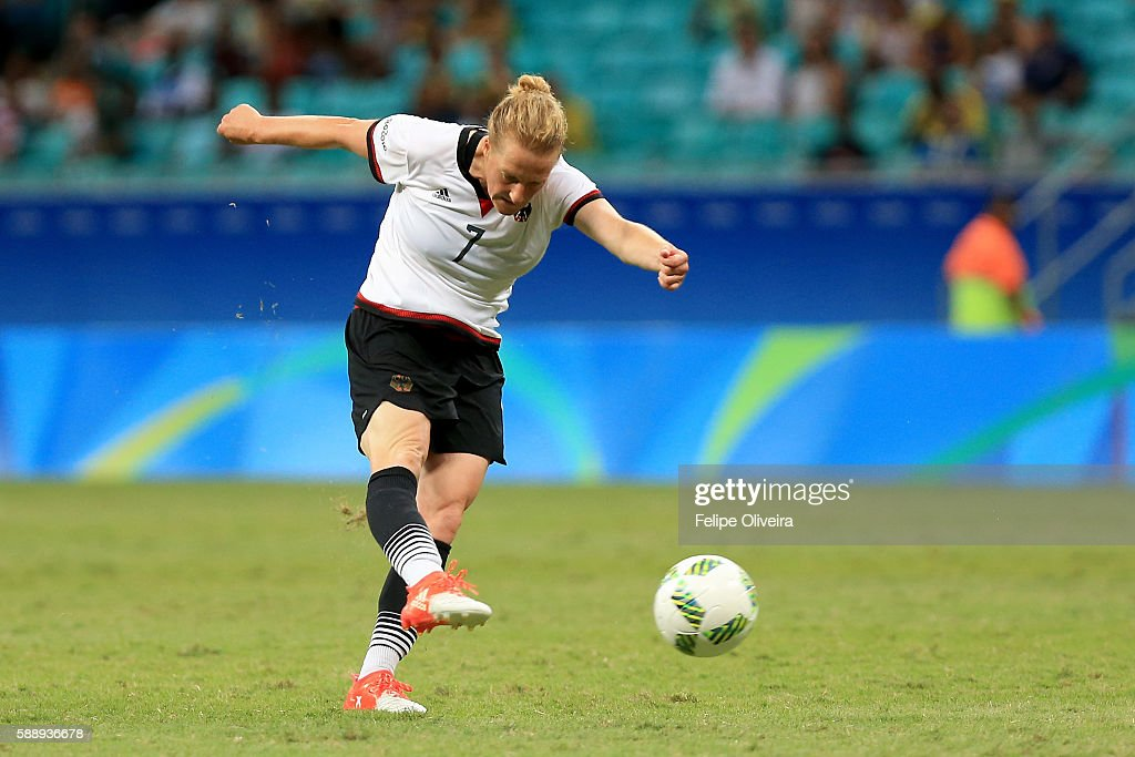 Melanie Behringer of Germany scores the opening goal during the Women's Football Quarterfinal match between China and Germany on Day 7 of the Rio 2016 Olympic Games at Arena Fonte Nova on August 12, 2016 in Salvador, Brazil.