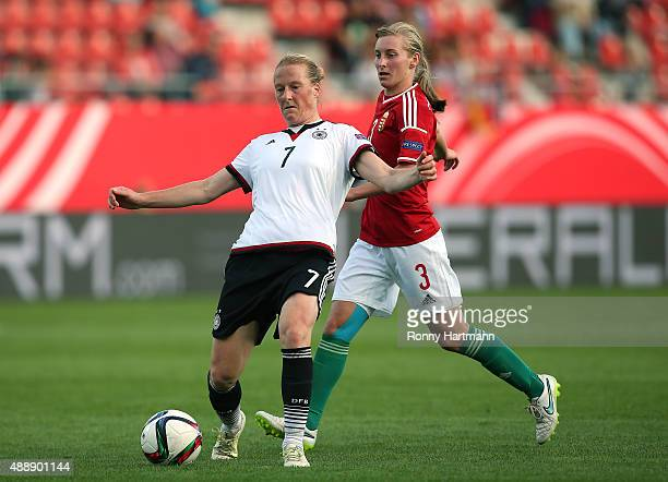 Melanie Behringer of Germany vies with Henrietta Csiszar of Hungary during the UEFA Women's Euro 2017 Qualifier between Germany and Hungary at Erdgas...