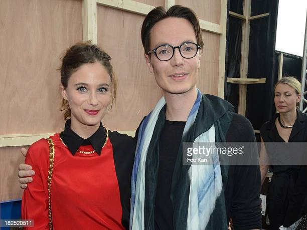 Melanie Bernier and Maxime Simoens attend the Maxime Simoens show as part of the Paris Fashion Week Womenswear Spring/Summer 2014 at the Parc Andre...
