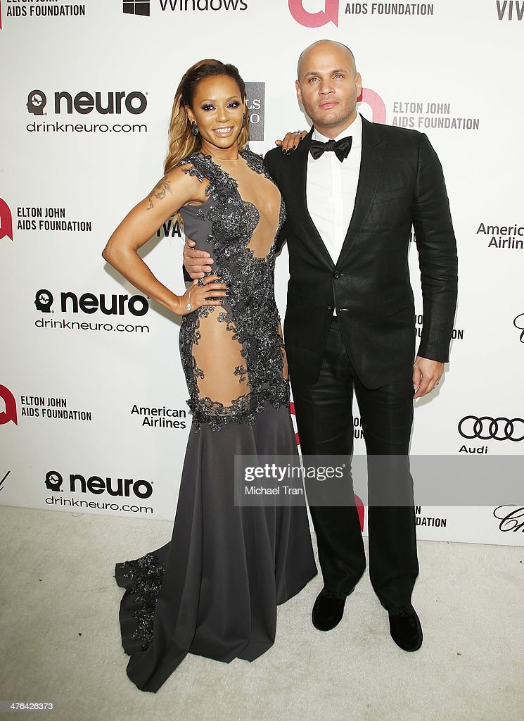 Melanie Brown and Stephen Belafonte arrive at the 22nd Annual Elton John AIDS Foundation's Oscar viewing party held on March 2, 2014 in West Hollywood, California.