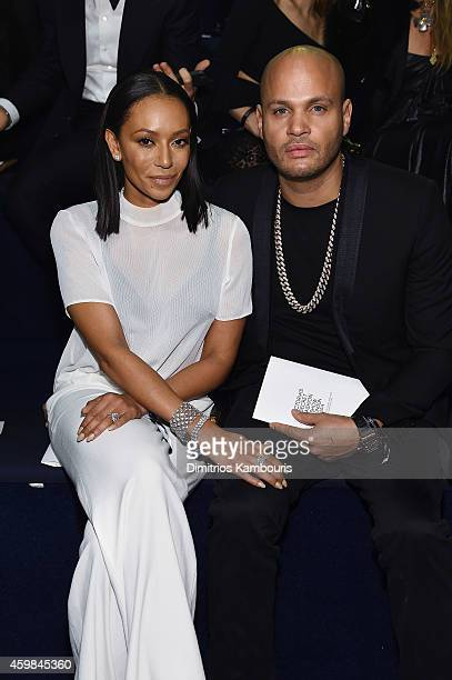 Melanie Brown and Stephen Belafonte attend the 2014 Victoria's Secret Fashion Show Show Front Row PreCocktail Reception at Earl's Court exhibition...