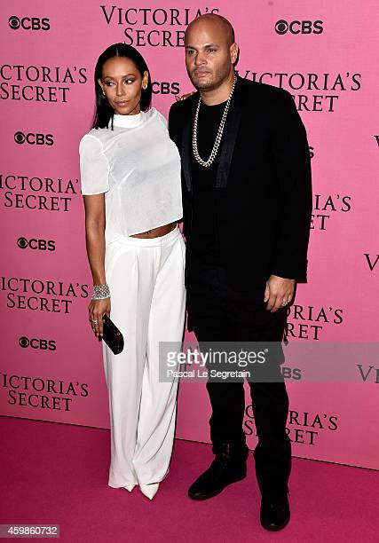 Melanie Brown and Stephen Belafonte attend the annual Victoria's Secret fashion show at Earls Court on December 2 2014 in London England