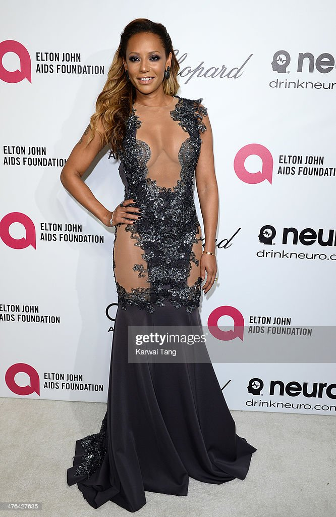 Melanie Brown arrives for the 22nd Annual Elton John AIDS Foundation's Oscar Viewing Party held at West Hollywood Park on March 2, 2014 in West Hollywood, California.