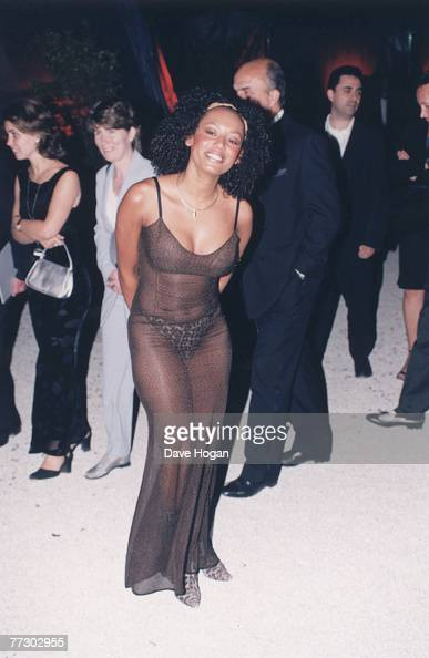 Melanie Brown of British pop group the Spice Girls wears a transparent gown over leopard print knickers to an event circa 1998