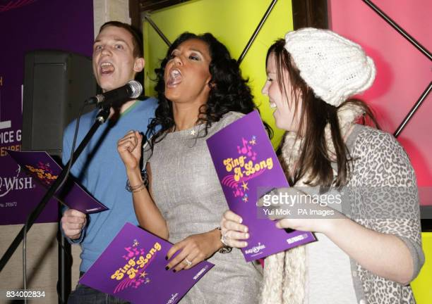 Melanie Brown sings Christmas carols to shoppers in Selfridges to help raise donations for the Make A Wish Foundation Oxford Street London