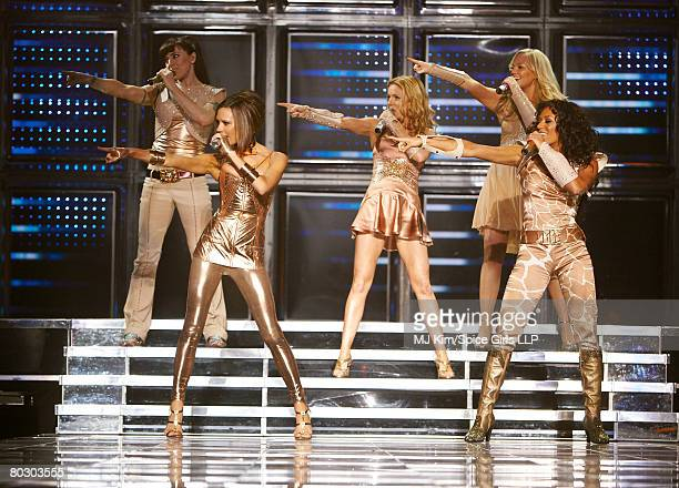 ACCESS *** Melanie Chisholm Victoria Beckham Geri Halliwell Emma Bunton and Melanie Brown of the Spice Girls perform on stage during The Return of...