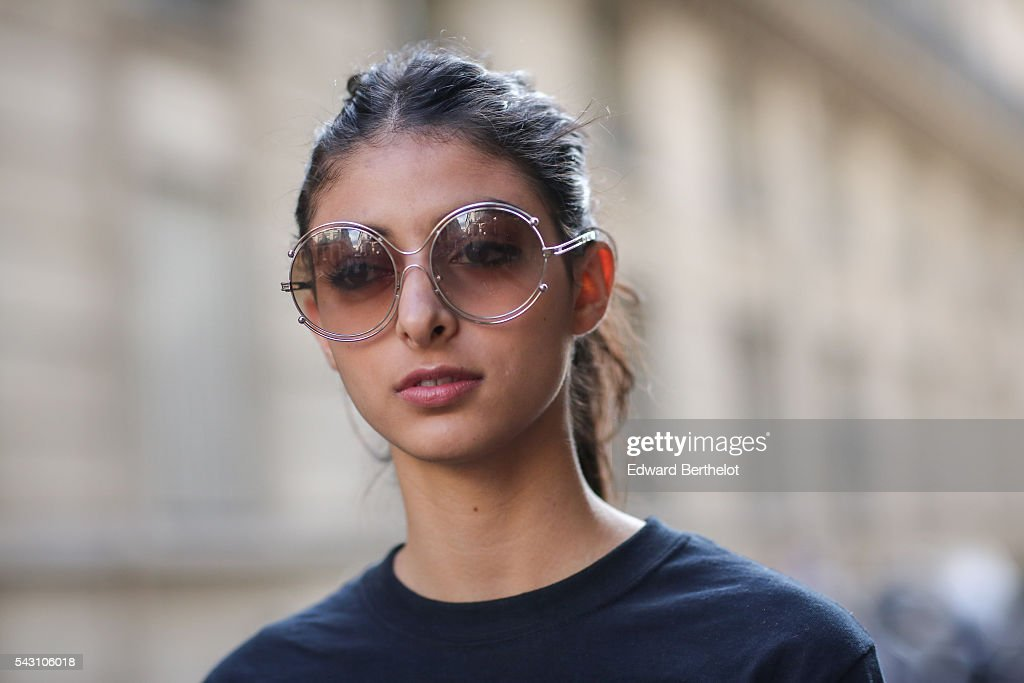 Melanie Darmon is wearing Chloe sunglasses, a Chloe bag, Chloe shoes, a Justin Bieber top, and Levis denim skirt, after the Henrik Vibskov show, during Paris Fashion Week Menswear Spring/summer 2017, on June 25, 2016 in Paris, France.