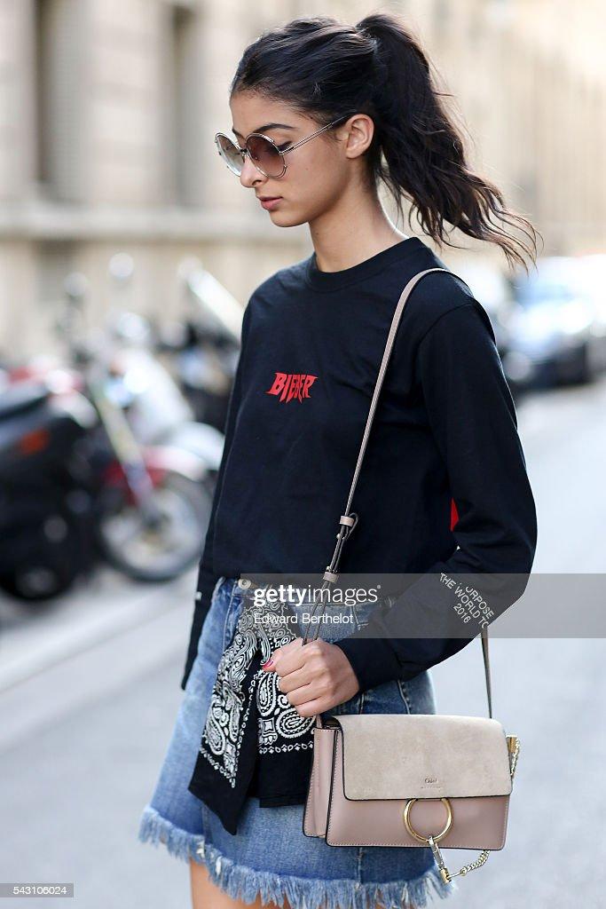 Melanie Darmon is wearing Chloe sunglasses, a Chloe bag, Chloe shoes, a Justin Bieber top, and Levis denim skirt, after the Henrik Vibskov show, during Paris Fashion Week Menswear Spring/summer 2017, on June 25, 2016 in Paris, France.