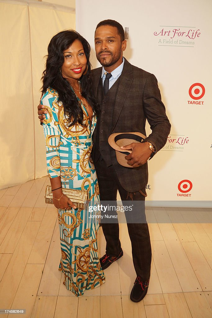 Melanie Fiona and Maxwell attend the 14th Annual Art For Life Gala: A Field Of Dreams at Fairview Farms on July 27, 2013 in Bridgehampton, New York.