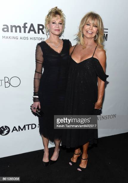 Melanie Griffith and Goldie Hawn at amfAR Los Angeles 2017 at Ron Burkle's Green Acres Estate on October 13 2017 in Beverly Hills Californi
