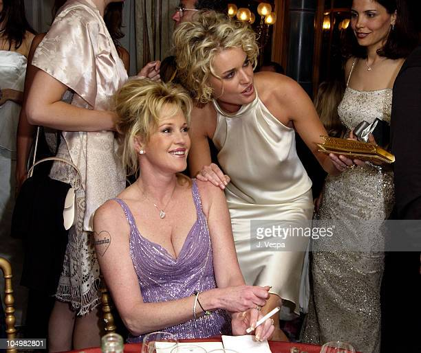 Melanie Griffith and Rebecca RomijnStamos during Cannes 2002 'Femme Fatale' Dinner at Le Dome Carlton Hotel in Cannes France