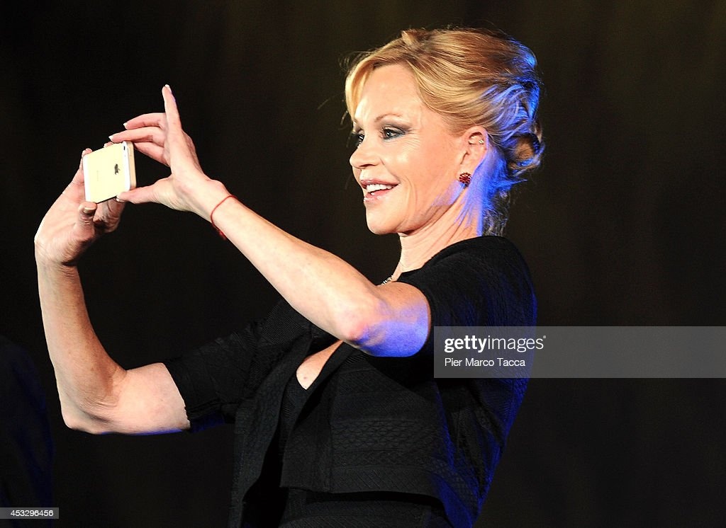 <a gi-track='captionPersonalityLinkClicked' href=/galleries/search?phrase=Melanie+Griffith&family=editorial&specificpeople=171682 ng-click='$event.stopPropagation()'>Melanie Griffith</a> attends 'Lucy' Premiere on August 6, 2014 in Locarno, Switzerland.