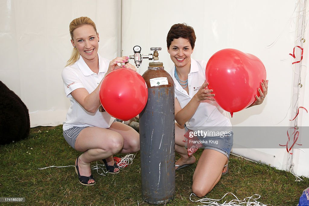 Melanie Kogler and Tatjana Kaestel attend the Charity Event Benefitting Flood Victims on July 20, 2013 in Grafenau, Germany.