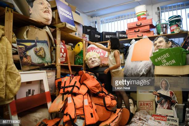 Melanie Kramers of Oxfam poses for a photograph while surrounded by assorted props used in political campaigns in the store room at Oxfam's...