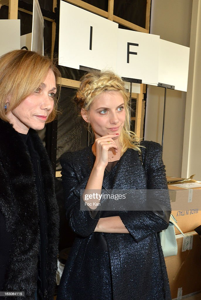 <a gi-track='captionPersonalityLinkClicked' href=/galleries/search?phrase=Melanie+Laurent&family=editorial&specificpeople=2721978 ng-click='$event.stopPropagation()'>Melanie Laurent</a> (R) and her mother attend the Maxime Simoens - Front Row - PFW F/W 2013 at the Foyer des Lyceennes Dr Blanche on March 3rd, 2013 in Paris, France.