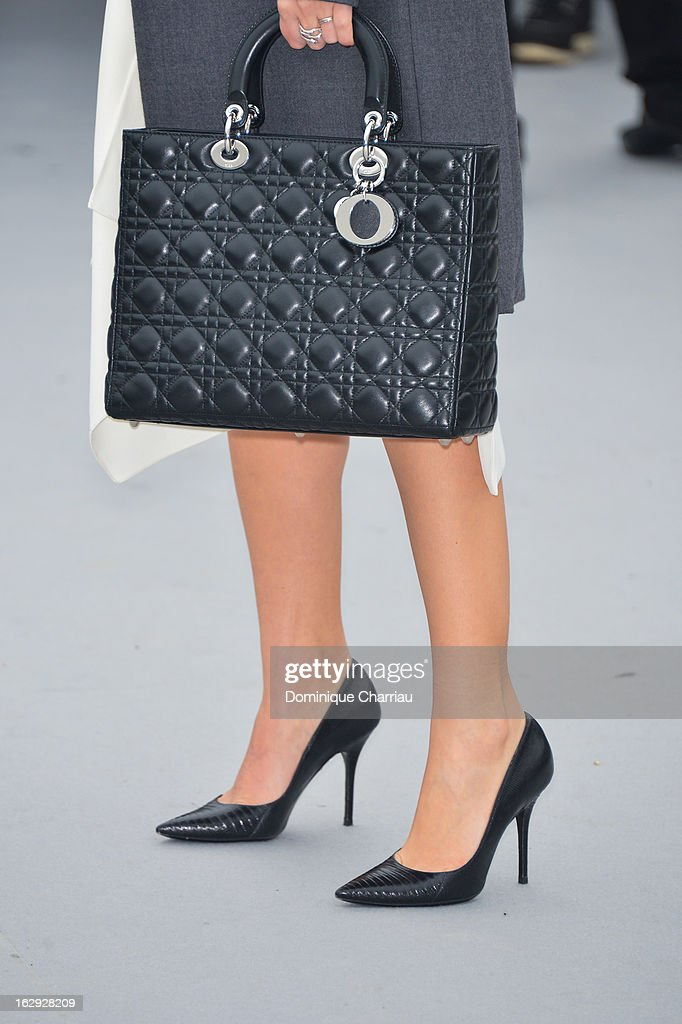Melanie Laurent (bag detail ) arrives at the Christian Dior Fall/Winter 2013 Ready-to-Wear show as part of Paris Fashion Week on March 1, 2013 in Paris, France.