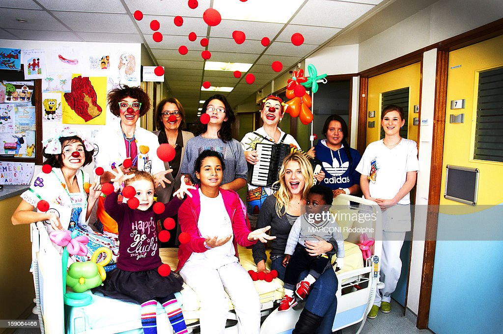 <a gi-track='captionPersonalityLinkClicked' href=/galleries/search?phrase=Melanie+Laurent&family=editorial&specificpeople=2721978 ng-click='$event.stopPropagation()'>Melanie Laurent</a> helps the association of the children in the hospital on November 28 in Paris, France.