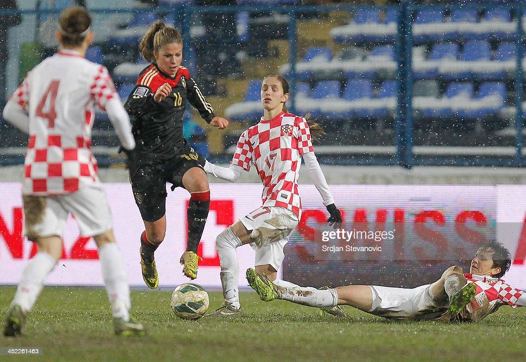Melanie Lepolz (L) of Germany is challenged by Izabela Lojna (C) and Violeta Baban (R) of Croatia during the FIFA Women's World Cup 2015 Qualifier between Croatia and Germany at Stadion Gradski Vrt on November 27, 2013 in Osijek, Croatia.