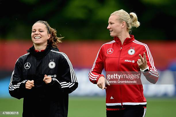 Melanie Leupolz and Alexandra Popp of Germany practice during a training session at Richcraft Recreation Complex on June 10 2015 in Ottawa Canada