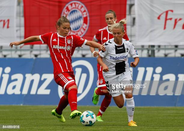 Melanie Leupolz of Bayern Muenchen and Julia Simic of SC Freiburg in action during the women Bundesliga match between Bayern Muenchen and SC Freiburg...