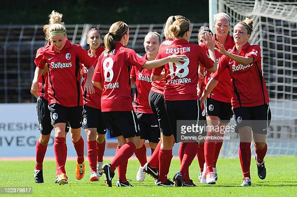 Melanie Leupolz of Freiburg celebrates with team mates after scoring her team's opening goal during the Women's Bundesliga match between SC Freiburg...